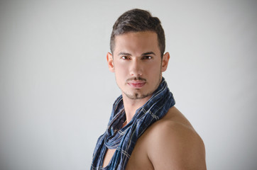Portrait of handsome young man shirtless with blue scarf
