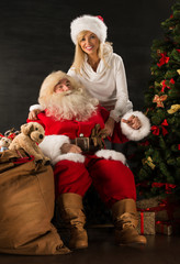 Happy Santa Claus with his wife at home.
