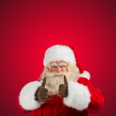 Authentic Santa Claus with real beard and great smiling giving t