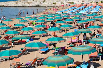 Crowded beach with umbrellas, Vieste, Apulia, Gargano,Italy