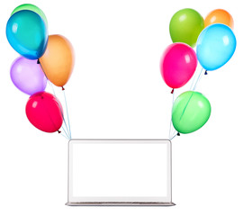 laptop computer hanging on color balloons