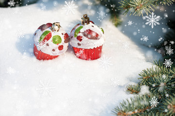 christmas toy cakes on winter tree with snow