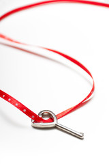 Heart shaped key and red ribbon