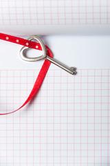 Heart shaped key on notebook