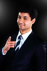 Vertical portrait of a happy young businessman