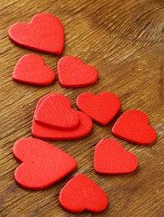 red heart, symbol of love on a wooden background