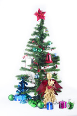 Decorated christmas tree on white background with gifts.