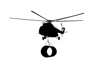 Silhouette of the helicopter with the load.