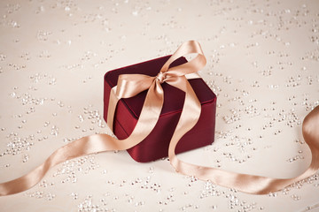 Luxury present on festive lighted background