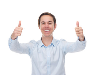 Portrait of a handsome young man smiling with thumbs up