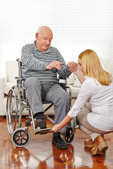 Physiotherapy with senior man in wheelchair