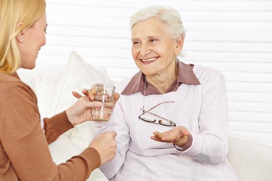 Senior citizen woman taking medical pill