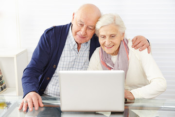 Wall Mural - Senior couple using ecommerce in internet