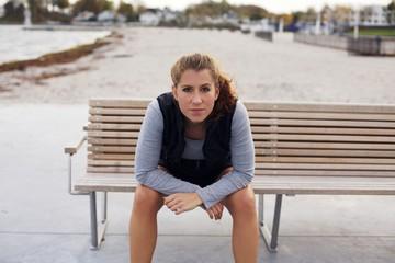 Beautiful young woman taking a break from running