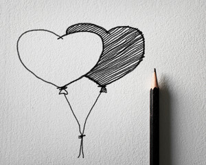 pencil sketching for heart balloon concept on white paper