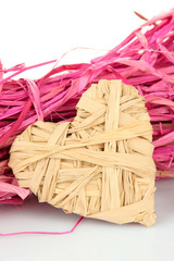 Decorative straw for hand made and heart of straw, isolated