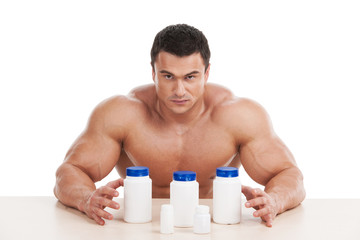 Muscular handsome bodybuilder with pills and dope.