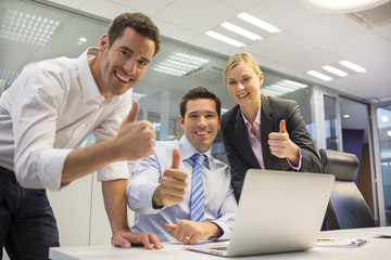 Happy business team in a office celebrating a success