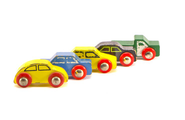 five old retro toy cars isolated on white background
