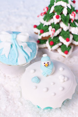 fondant cupcakes and frosted gingerbread christmas tree