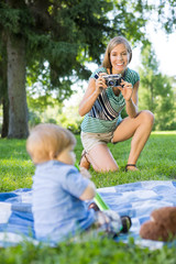 Woman Clicking Picture Of Baby Boy In Park