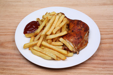 Fried fries and baked chicken leg