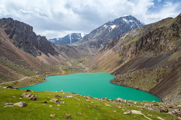 Fototapete - Turquoise wonderful lake in mountains of Tien Shan