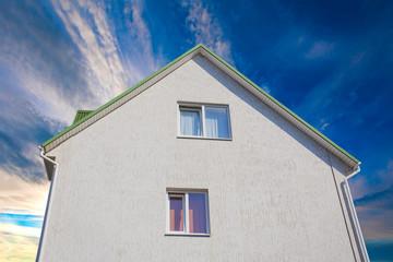 lovely house on a blue sky background