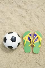 Soccer Ball Football and Flip-Flops on Brazilian Beach