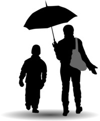 mother and son walk  under the umbrella