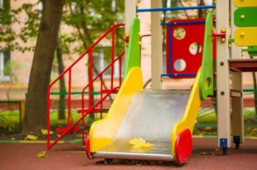 Small slide on autumn kids playground