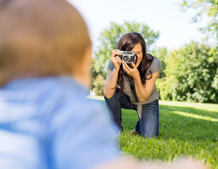Woman Photographing Baby Son