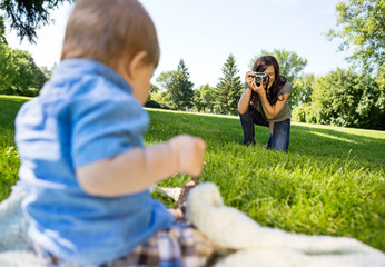 Woman Photographing Baby Boy In Park