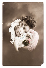 antique portrait of lucky mother with her cute baby