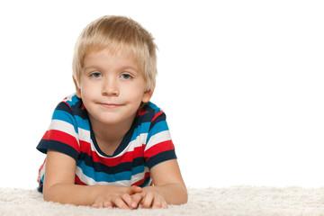 Cute  boy on the white carpet