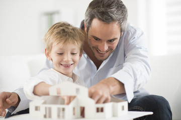 father and son building a model house