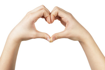 female teen hand makes heart shape with hands