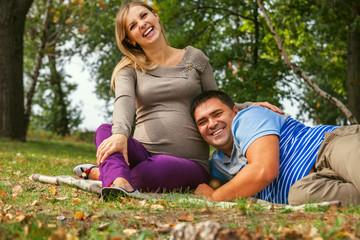 Portrait happy smiling couple of future parents