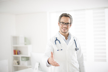 young doctor welcoming at his office