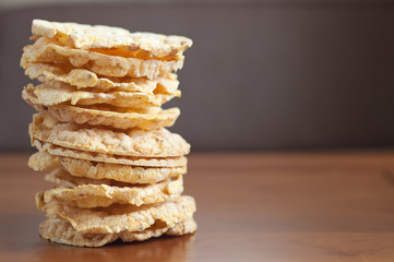 Rice cakes stacked on wooden background