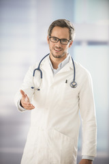 doctor holding out his hand as a sign of hospitality