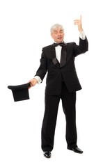 Elegant man in tuxedo and top hat a white background.