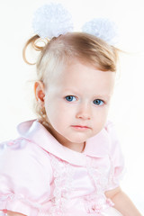portrait of thoughtful little baby girl isolated on white