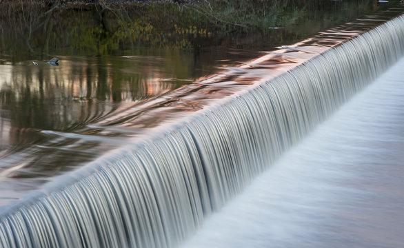 motion blurred river weir