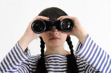 young female sailor looking through binoculars