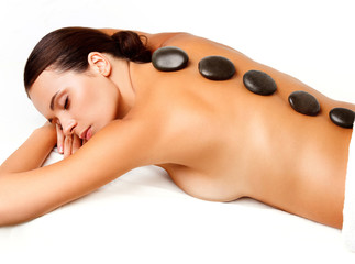 Wall Mural - Stone Massage. Beautiful Woman Getting Spa Hot Stones Massage in