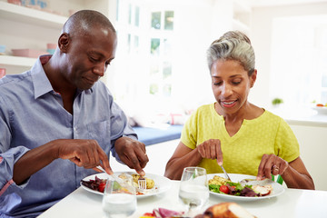 Mature African American Couple Eating Meal At Home