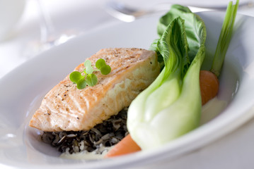 salmon dinner with wild rice, bok choy and carrot.