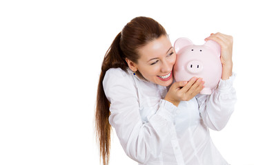 Excited young woman holding a piggy bank
