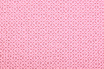 Pink fabric with dots, background.